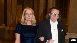 FILE - Swedish Academy member Katarina Frostenson and her husband Jean-Claude Arnault arriving for the Kings Nobel dinner at the Royal Palace in Stockholm, Dec. 11, 2011.