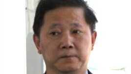 FILE - Sun Yuxi at the time Chinese Ambassador to Afghanistan sits on a bus at Kabul airport, June 10, 2004.