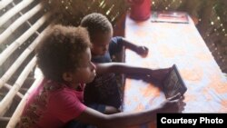 Students in Vanuatu use the SolarSPELL offline library (Photograph courtesy of Dr. Laura Hosman)