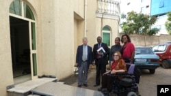 Special Advisor Judy Heumann tries out the brand new ramp installed at the offices of the African Child Policy Forum (ACPF).