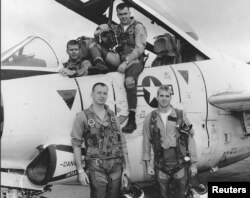 John McCain, bottom right, poses with his U.S. Navy squadron in 1965.