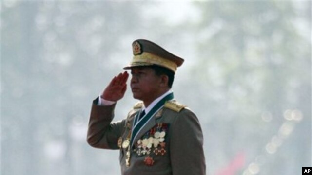 Burmese Gen. Min Aung Hlaing salutes the national flag during a ceremony marking the country's 67th Armed Forces Day in Naypyitaw, Burma, March 27, 2012.