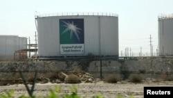 FILE - Oil tanks are seen at the Saudi Aramco headquarters in Damam city, Nov. 11, 2007.