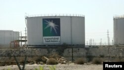 FILE - Oil tanks are seen at the Saudi Aramco headquarters in Damam city, Nov. 11, 2007.
