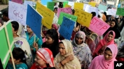 Pakistani women observe the International Day for the Elimination of Violence against Women, in Lahore, Pakistan, Nov. 25, 2015.