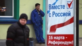 A poster calling for people to vote in the upcoming referendum is seen in Simferopol March 11, 2014.