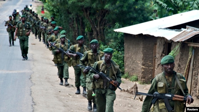 FILE - Congolese soldiers patrol the town of Rutshuru in eastern Congo, January 28, 2009.