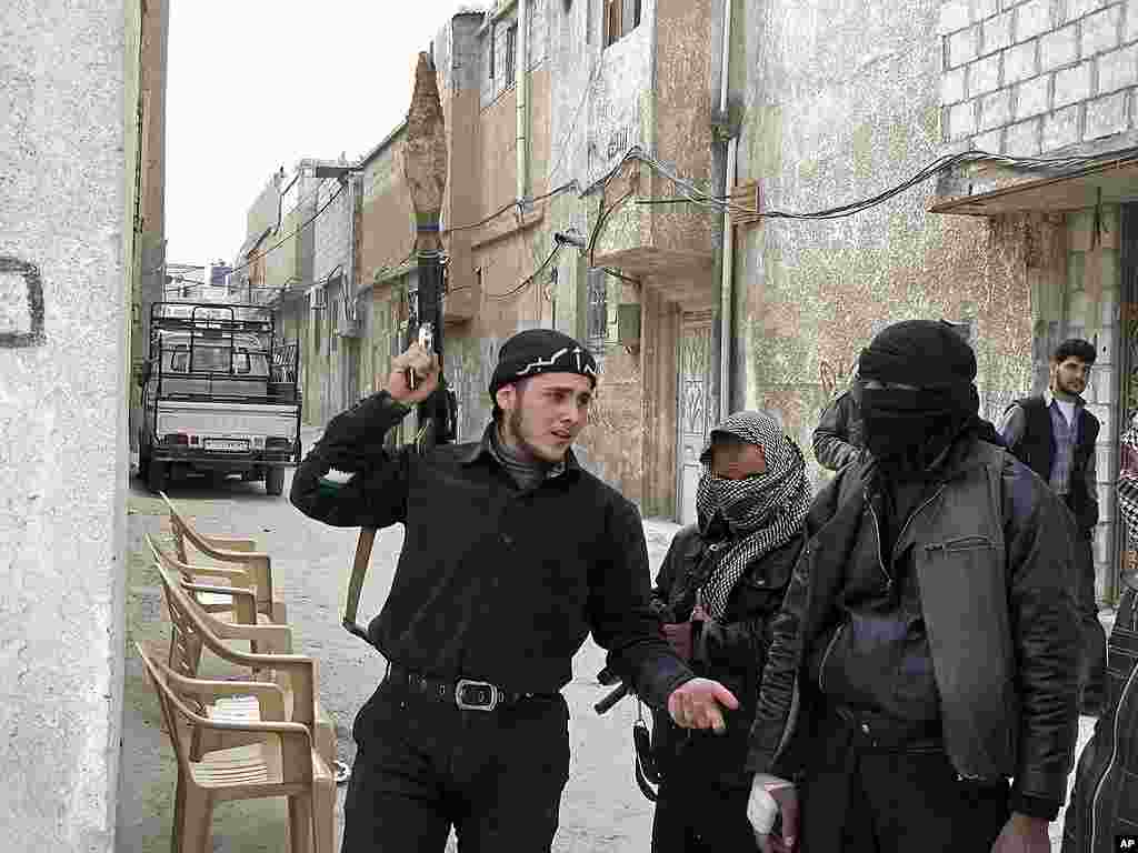 Free Syrian Army fighters are seen in a neighborhood in Damascus. (AP)