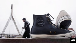 "Here, a sculpture of the classic ""Chuck Taylor"" (Chuck T) sneakers are outside the world headquarters of Converse, Inc. in Boston (Dec. 29, 2016.)"