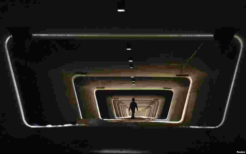A worker walks in the foundation of a new railway line in Yiwu, Zhejiang province, China.