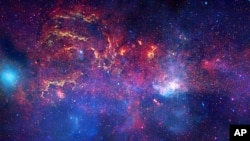 An unprecedented image of the central region of our Milky Way galaxy using infrared light and X-ray light to see through the obscuring dust and reveal the intense activity near the galactic core, FILE November 11, 2009.