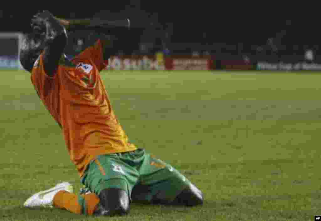 """Zambia's James Chamanga celebrates after scoring a goal against Sudan during their African Nations Cup quarter-final soccer match at Estadio de Bata """"Bata Stadium"""", in Bata February 4, 2012."""