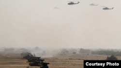 FILE - Pakistan's army tanks and helicopters, seen in this army-issued photo, take part in a military exercise in Khairpur Tamiwali, Pakistan.