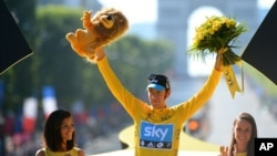 Bradley Wiggins, winner of the 2012 Tour de France cycling race, on the podium of the race in Paris, France, July 22, 2012