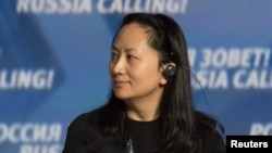 FILE - Meng Wanzhou, Executive Board Director of the Chinese technology giant Huawei, attends a session of the VTB Capital Investment Forum in Moscow, Oct. 2, 2014.