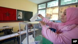 A Moroccan woman casts her ballot in a polling station for the municipal elections in Casablanca, Morocco, Sept. 4, 2015.