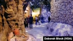 In the museum, visitors can walk through a recreation of Nazareth, the town where Jesus grew up, with hand-painted trees and the sound of chirping birds.