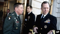 Navy Adm. Mike Mullen, chairman of the Joint Chiefs of Staff (right) is welcomed to the 3rd Annual U.S. Central Command Chiefs of Defense Conference by U.S. Army Gen. David Petraeus, commander, USCENTCOM at the Fairfax Hotel, Washington, D.C., 25 Jan 2010