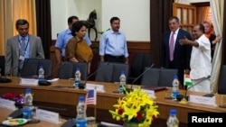 U.S. Defense Secretary Leon Panetta (2nd R) is shown into a conference room by his Indian counterpart A.K. Antony (R) during a meeting in New Delhi, June 6, 2012.