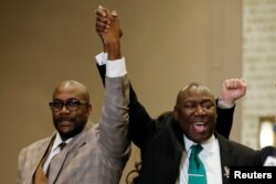 Floyd family attorney Ben Crump and Philonise Floyd raise their fists during a news conference following the verdict in the trial of former Minneapolis police officer Derek Chauvin, found guilty of the death of George Floyd, in Minneapolis, Minnesota