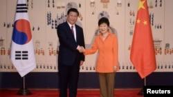中国国家主席习近平和韩国总统朴槿惠在首尔举行两国首脑会谈.(2014年7月3日)