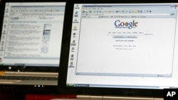 FILE - Computers display the Google Desktop search engine, Oct. 14, 2004.