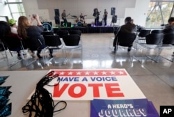 FILE - A small crowd watches the band Gypsy Temple during a performance by the group urging youth to participate in the November election at Shoreline Community College, Oct. 25, 2018, in Shoreline, Wash.