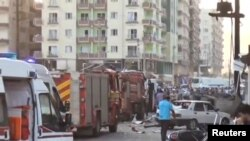 A still image taken from a video footage shows emergency vehicles at the scene of a bomb blast in Kiziltepe, Turkey, Aug. 10, 2016.
