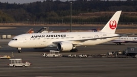 A Japan Airlines' (JAL) Boeing Co's 787 plane is seen at New Tokyo international airport in Narita, Jan. 9, 2013.