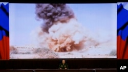 Lt. Gen. Sergei Rudskoi of the Russian military's General Staff speaks at a briefing about airstrikes in Syria in Moscow, April 11, 2016.