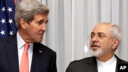 FILE - U.S. Secretary of State John Kerry, left, listens to Iran's Foreign Minister Mohammad Javad Zarif, right, before resuming talks over Iran's nuclear program in Lausanne, Switzerland.