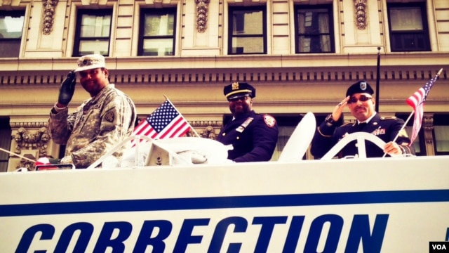 New York City Department of Corrections officers who are also proud military veterans had their own patriotic float in Monday's Veterans Day Parade up Fifth Avenue. (VOA/A. Phillips)