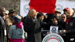 FILE- Civil right leader Rev. Al Sharpton speaks at Freedom plaza in Washington, D.C., Dec. 13, 2014. On Saturday, Sharpton is to lead a march along the National Mall ending at the Martin Luther King Jr. Memorial in the U.S. capital.