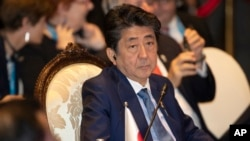 This Nov. 4, 2019, file photo, Japan's Prime Minister Shinzo Abe, attends East Asia summit in Nonthaburi, Thailand. (AP Photo/Sakchai Lalit, File)