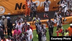 Highlanders players captured after receiving the Easycall Cup at Barbourfields Stadium. (Courtesy: Ezra Sibanda)