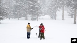 California Cooperative Snow Surveys Program for the Department of Water Resources employees conduct a manual snow survey of the season at Phillips Station near Echo Summit, Calif., Feb. 2, 2016.
