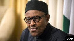 FILE - Nigerian president Muhammadu Buhari gives an interview to Agence France-presse at his hotel during the 25th African Summit on June 14, 2015 in Johannesburg.