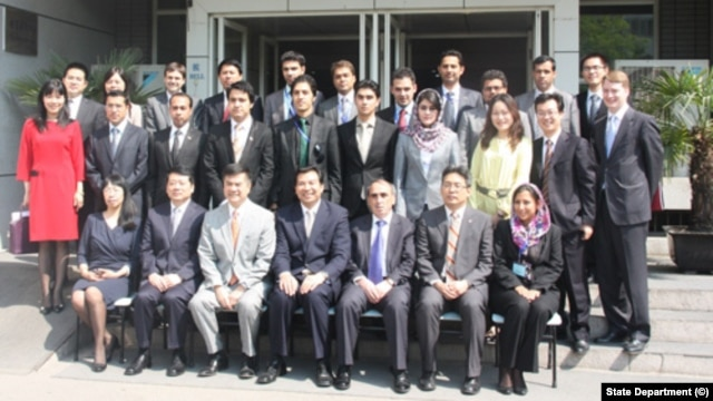 FILE - Participants in a joint program to train Afghan diplomats are seen outside the U.S. embassy in Beijing in this State Department  photo.