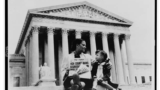 A mother explains the Supreme Court's decision to her three-year-old daughter, November 19, 1954.