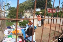 Women sell fruit outside the gates of Zithulele Hospital … In the same spot as Motlhabane's mother once did