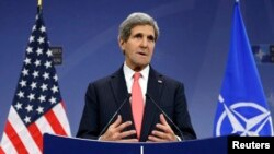 U.S. Secretary of State John Kerry speaks at a news conference during a NATO foreign ministers meeting in Brussels December 3, 2013.