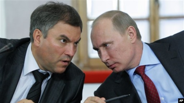 FILE - Then-Russian Prime Minister Vladimir Putin, right, speaks with his then-Chief of Staff Vyacheslav Volodin during a meeting of officials in Pskov in May 2011. Volodin is on a list of Russian officials facing U.S. sanctions.