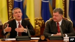 Ukrainian President Petro Poroshenko (R) looks at NATO Secretary-General Jens Stoltenberg as he speaks during a meeting of the National Security and Defense Council of Ukraine in Kyiv, Ukraine, Sept. 22, 2015.