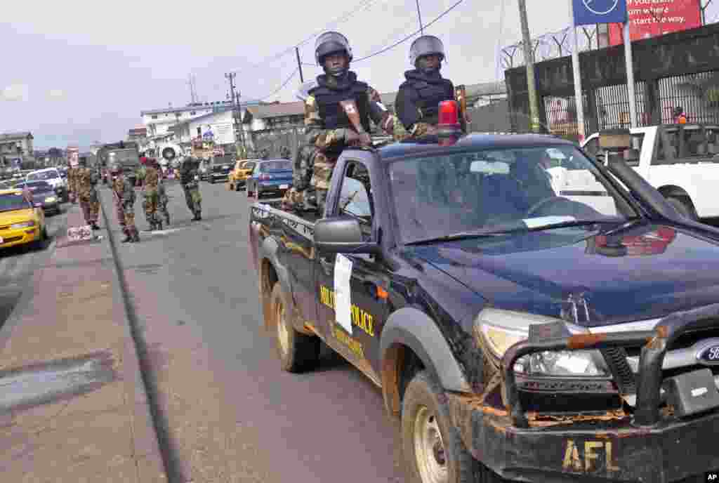 Liberian soldiers patrol the streets on foot and in vehicles to help prevent panic, Monrovia, Liberia, August 1, 2014.