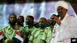 Sudanese President Omar al-Bashir speaks at the National Congress Party headquarters in Khartoum, April 18, 2012. Addressing a youth rally, Bashir threatened to overthrow the government of South Sudan.