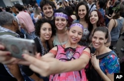 Women pose for a group photo during a protest against Jair Bolsonaro, the presidential front-runner, and far-right congressman, in Sao Paulo, Brazil, Sept. 29, 2018.