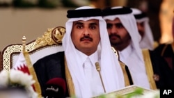 FILE- Qatar's Emir Sheikh Tamim bin Hamad Al-Thani attends a Gulf Cooperation Council summit in Doha, Qatar, Dec. 9, 2014.