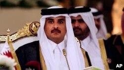 FILE- Qatar's Emir Sheikh Tamim bin Hamad al-Thani attends a Gulf Cooperation Council summit in Doha, Qatar, Dec. 9, 2014.