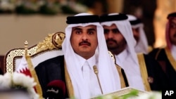 FILE- Qatar's emir, Sheikh Tamim bin Hamad Al Thani, attends a Gulf Cooperation Council summit in Doha, Qatar, Dec. 9, 2014.
