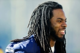 Seattle Seahawks cornerback Richard Sherman walks off the field after football practice, Jan. 24, 2014, in Renton, Washington.